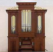 Our comprehensive restoration of this instrument, the second oldest known Johnson organ, included replication of the original faux-grain walnut finish on its pine casework.  We also retained the original hand-pumping mechanism